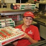 woman worker of Pino's Pizza holding box of Pino's Pizza of OCMD
