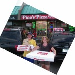 boy carrying pizza and woman carrying XXL pizza from Pino's Pizza