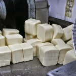 large blocks of mozzarella cheese near slicer
