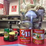 Pino's Pizza ingredients of ground tomatoes and spices on table