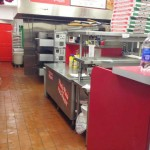 a clean profesional kitchen of Pino's Pizza
