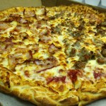 Pino's Pizza with half ham half sausage
