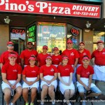 a staff of 12 people posing in front of Pino's Pizza in Ocean City MD